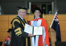NSW Deputy Police Commissioner Catherine Burn is presented with an honorary doctorate by Chancellor Michael Egan. Photo: Effy Alexakis.
