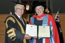 Maggie Beer receives an honorary doctorate from Chancellor Michael Egan (1.4MB) Photo: Effy Alexakis.