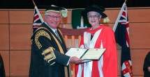 Chancellor The Hon Michael Egan AO presents The Hon Catherine Branson QC with her honorary doctorate. Credit: Dermot Walsh