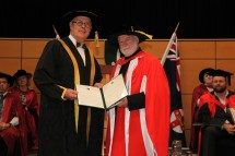 Vice-Chancellor, Professor S. Bruce Dowton presents Phillip Adams AO with the honorary doctorate. Credit: Dermot Walsh