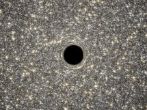 A new study has discovered the smallest galaxy yet known to harbor a supermassive black hole.