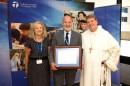 Archbishop Anthony, Mark Gronow and Joanne Mulligan.