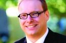 Dr Chris Baumann