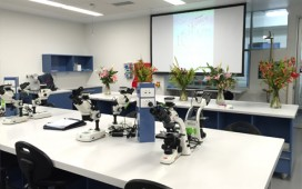 Microscopes and flowers on display inside the Biology labs