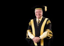 The Hon Michael Egan, AO Chanellor in academic dress