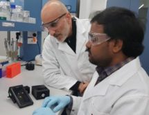 Researchers Anwar Sunna (right) and Vinoth Kumar Rajendran with their smartphone-enabled MRSA detector. Credit: Sunna Lab