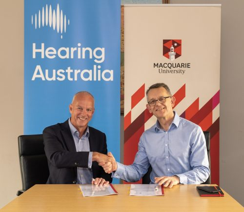 https://webresources.mq.edu.au/newsroom/wp-content/uploads/2019/12/Kim-Terrell-HA-David-Wilkinson-MQ_signing1.jpg