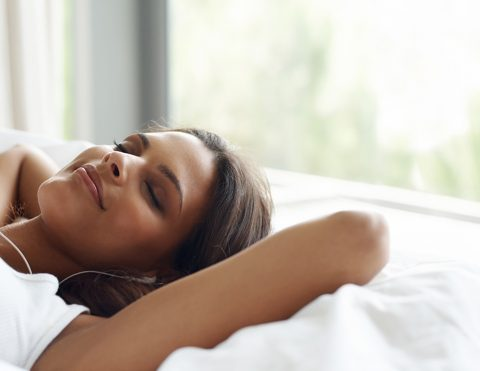 Shot of a young woman listening to music in bedhttp://195.154.178.81/DATA/istock_collage/0/shoots/783395.jpg